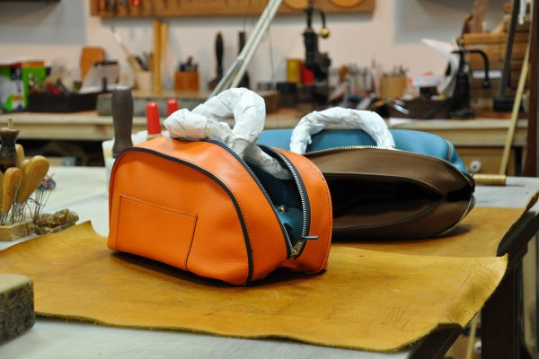 The craftsman must be delicate when he returns the leather bag. French savoir-faire by LE NOËN