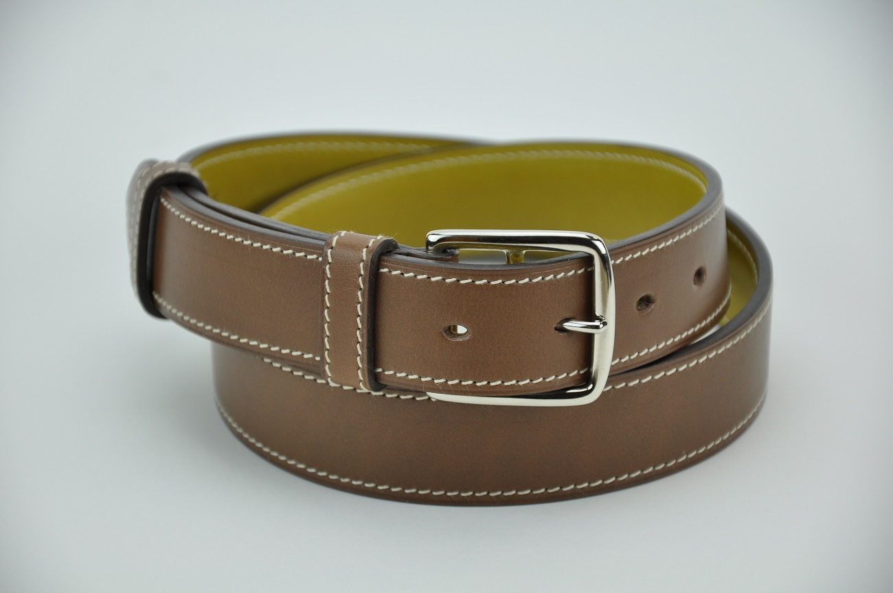 Belt in brown cowhide with solid brass buckle, nickel plated finish. Hand made in France for special custom-made.