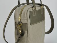 Weekend bag in leather and linen, a vintage style made by a French leathergoods designer.