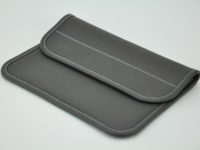 Clutch bag for woman in dark grey taurillon, made by French leather goods maker.
