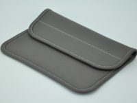 Clutch bag made in light grey taurillon leather by French accessories designer.
