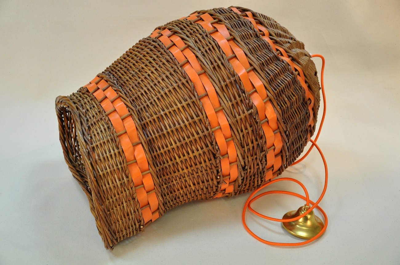 Wicker and leather lamp for your living room, an original object made by LE NOËN leather goods designers in France.