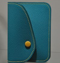 Purse in leather, bank card, coins, bills for woman and man. Leather goods craftsman in France.